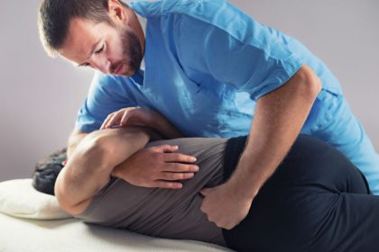 Chiropractor performing a spinal adjustment.