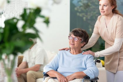 Elderly woman with caregiver in wheelchair