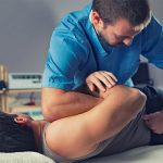 Chiropractor doing spinal adjustment