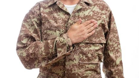 military person with hand over heart