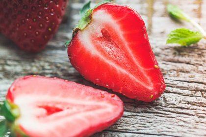 Ripe strawberry sliced in half.